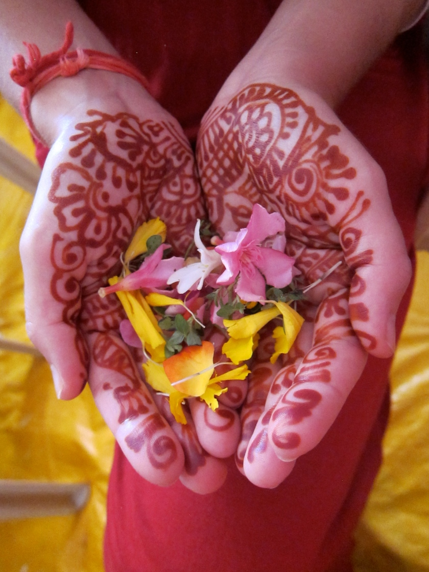 Henna hands and wedding flowers