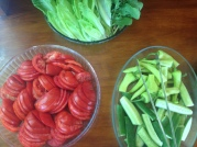 Tomatoes, cucumbers, and greens.